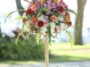 Close-Up of Gold Candleabra Centerpiece with Colorful Flowers
