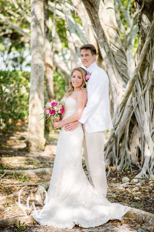Couple with Bridal Bouquet in Shades of Pink Cream and Green