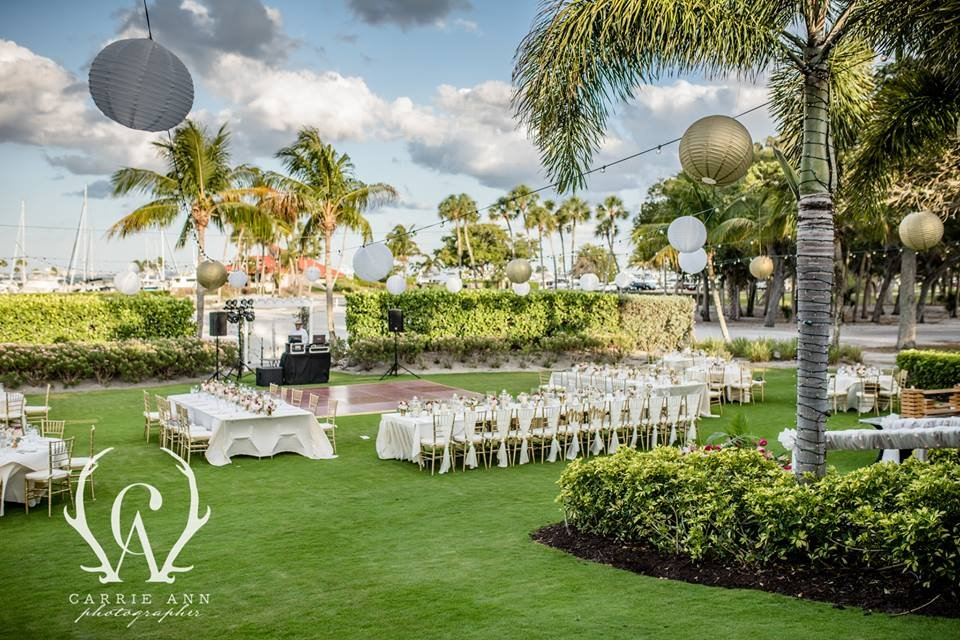 Reception on Lawn Near Marina with Feasting Tables