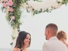 Couple under the Wedding Arch