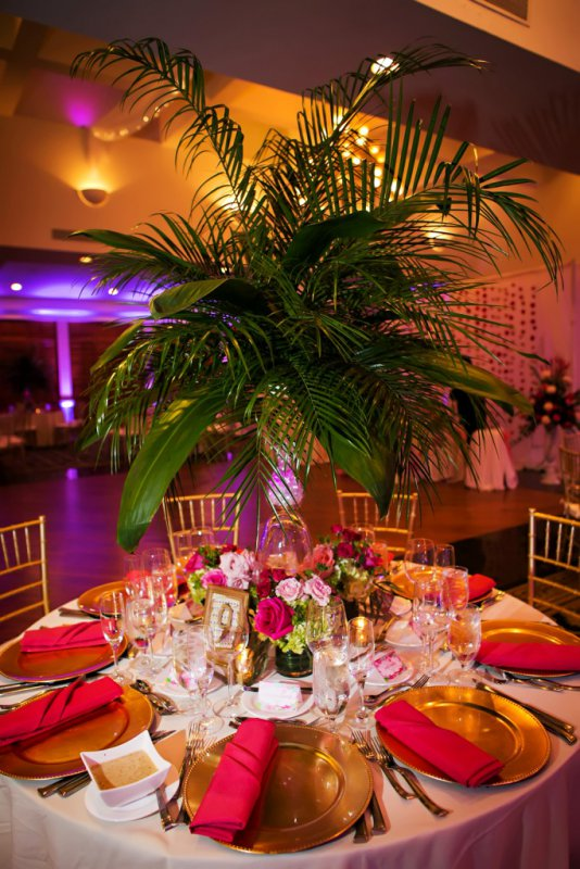 Elevated Reception Centerpiece with Palms and Rose Arrangements Below