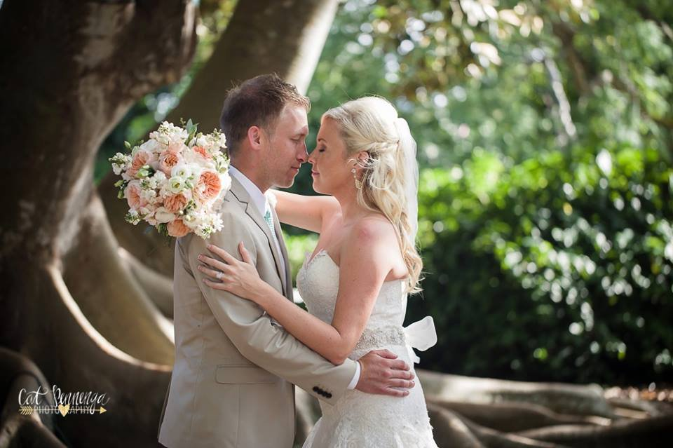Bride and Groom in Garden with Bridal Bouquet