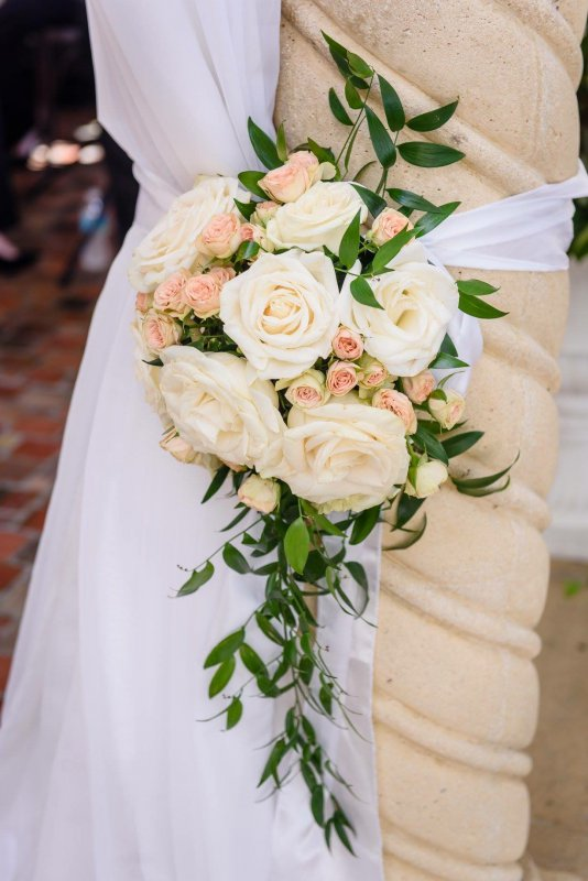 Flowers on Columns with Tied Back Sheer Fabric for Ceremony