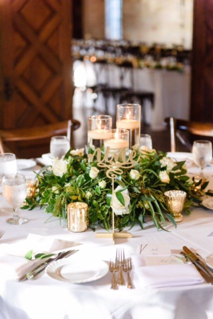 Guest Table with Greenery and Flowers and Cylinders with Candles