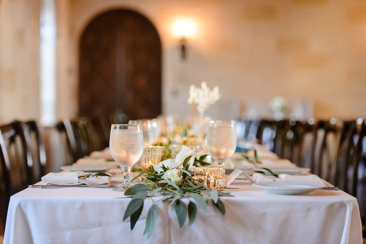 Table Runners of Greenery, Flowers, and Votives