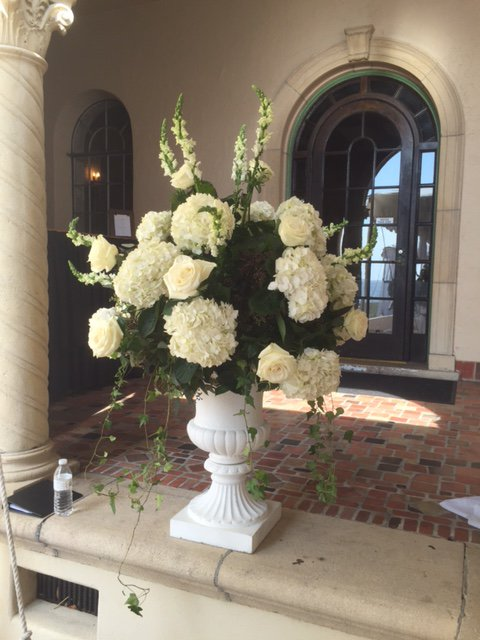 Urn with White Flowers on Loggia for Ceremony