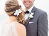 Groom's boutonnière and Bride's hair flowers