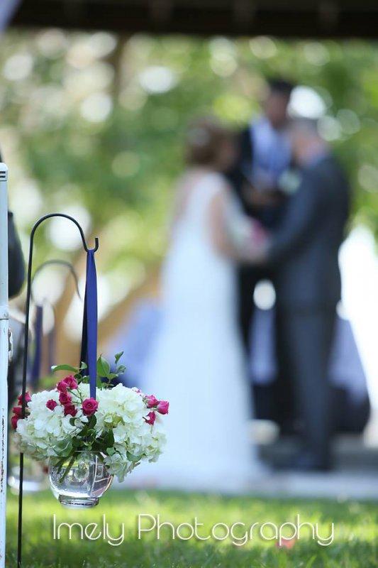Wedding Aisle Flowers in Shepherd Hooks