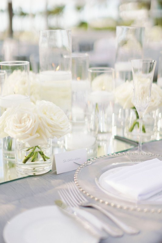 Close Up of Feasting Table with All-White Flowers, Candles, and Mirror Runner