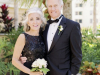 Mother with All-White Small Bouquet and Father with Double Spray Rose Boutonniere