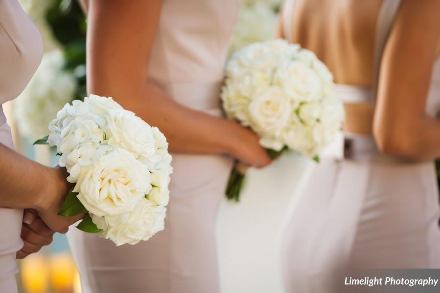 All-white bridesmaids' bouquet of hydrangea and garden spray roses