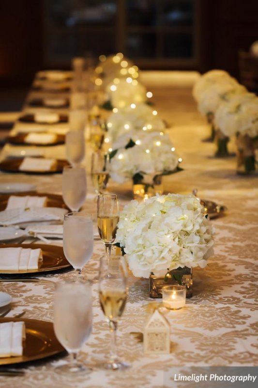 End of Head Table with Several Small Hydrangea Cubes with Fairy Lights
