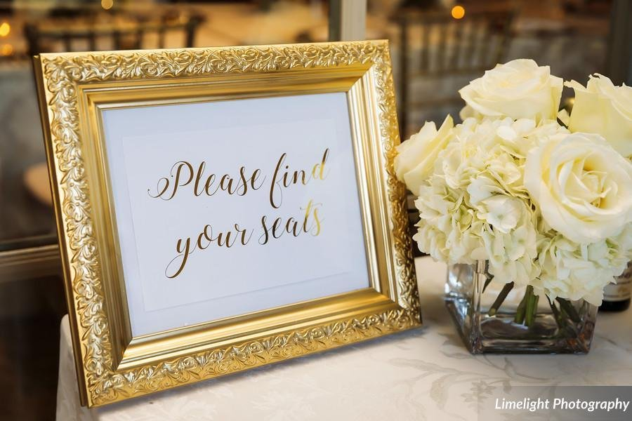 Place Card Table with All-White Arrangement