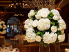 Elevated Guest Table Centerpiece Arrangement with Hydrangea, garden roses, curly willow and fairy lights