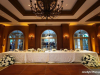 Head Table with 2 Floral Arrangements from Outside Columns in Front of Table
