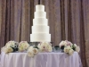 White Wedding Cake with Flowers at the Base