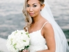 Bride with all White Roses and Freesia