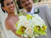 Bridal bouquet of green orchids, callas, and roses