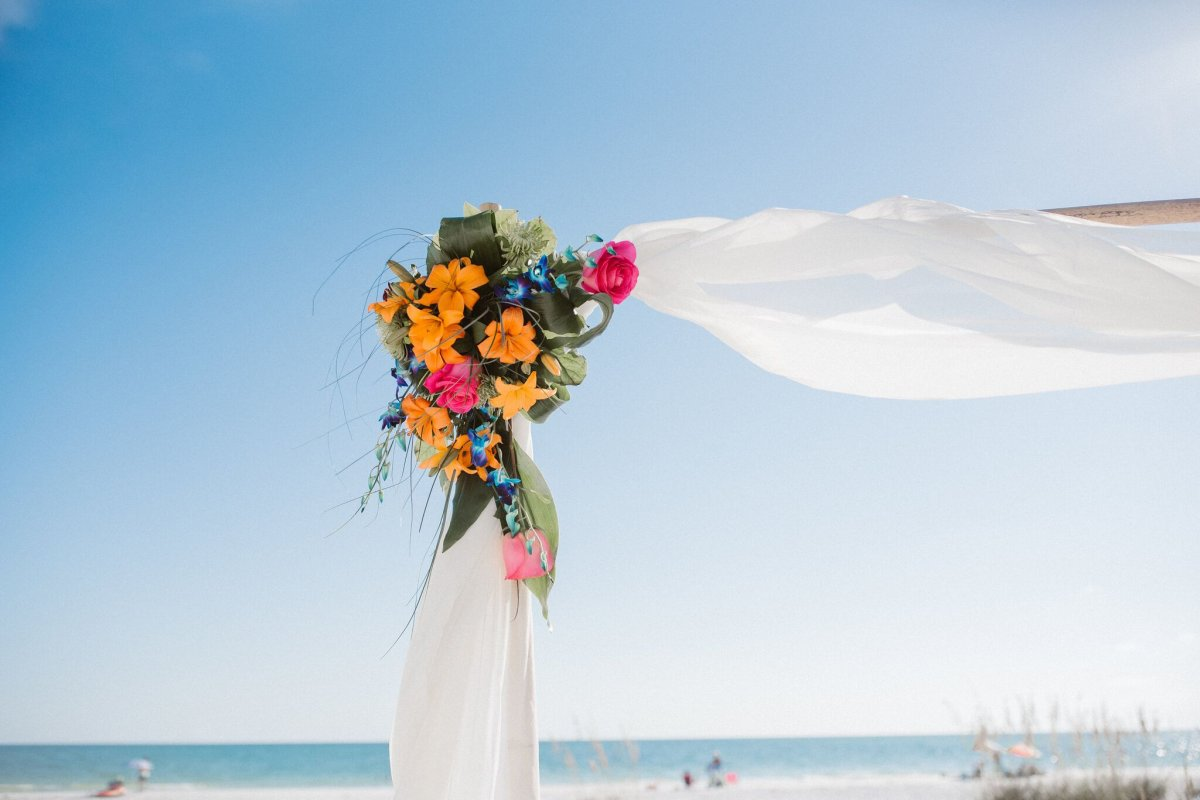 Close Up of Tropical Floral on Arch for Beach Ceremony