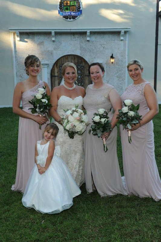 Bride with Bridesmaids and their Bouquets and Flower girl