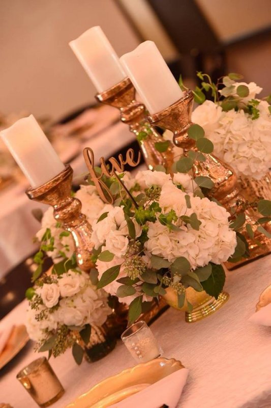 Composite Arrangements with Gold Pillar Candles and Flowers in Mercury Glass