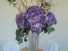 silver-vase-with-curly-willow-purple-hydrangea-and-green-orchids