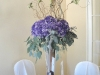 silver-vase-with-purple-hydragnea-and-willow-w-orchids