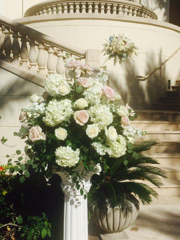 Beautiful floral arrangement at base of steps