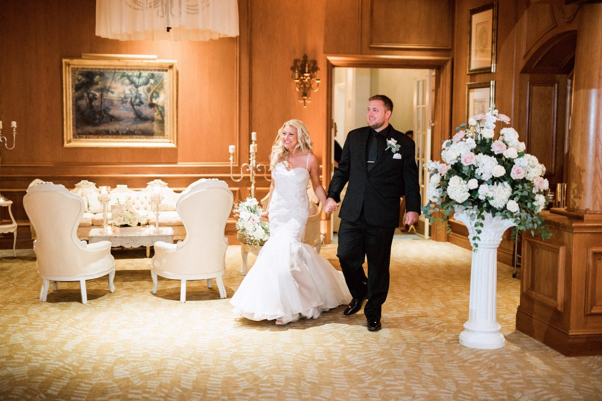 Couples Entrance to Reception with Floral Decor