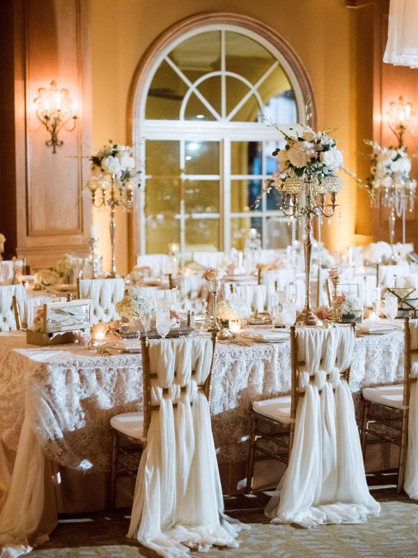 Gorgeous detailed chair draping and reception table centerpieces