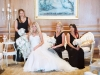 Bride with bridesmaids on So Staged sofa