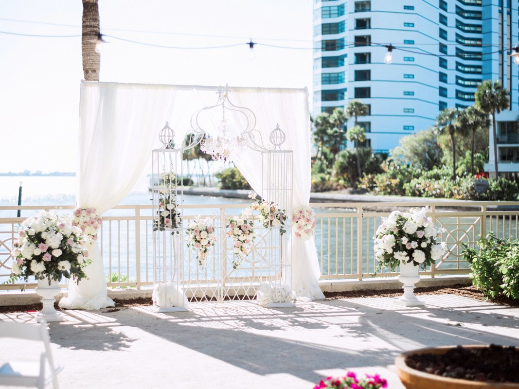 Urns Backdrop with Wedding Arch and Blush Flowers