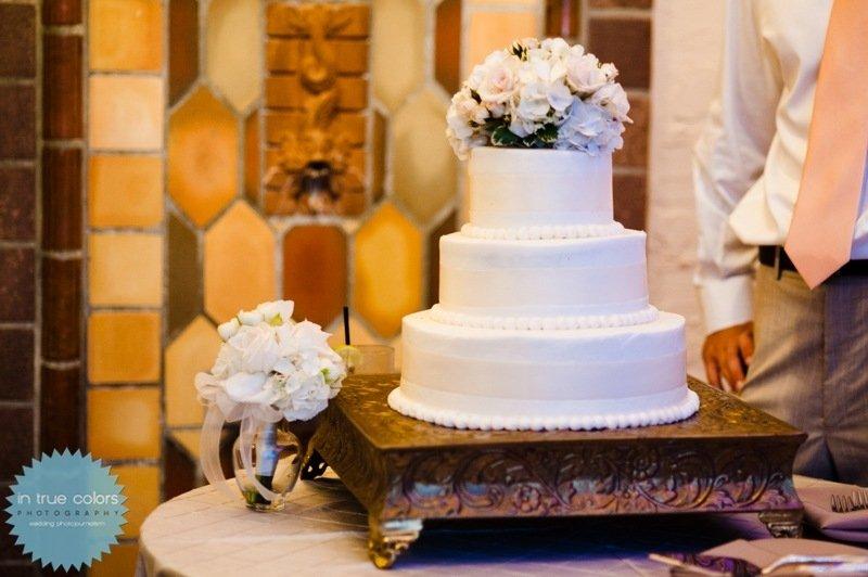 wedding cake with bouquet to throw, destination wedding