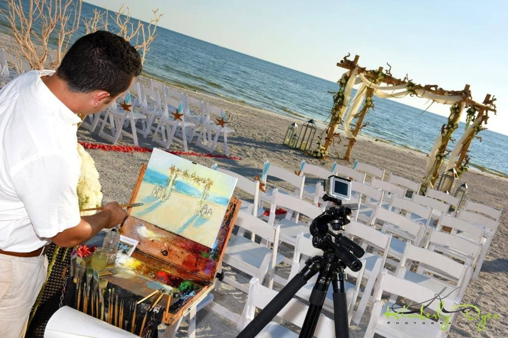 Artists painting Beach Wedding Scene