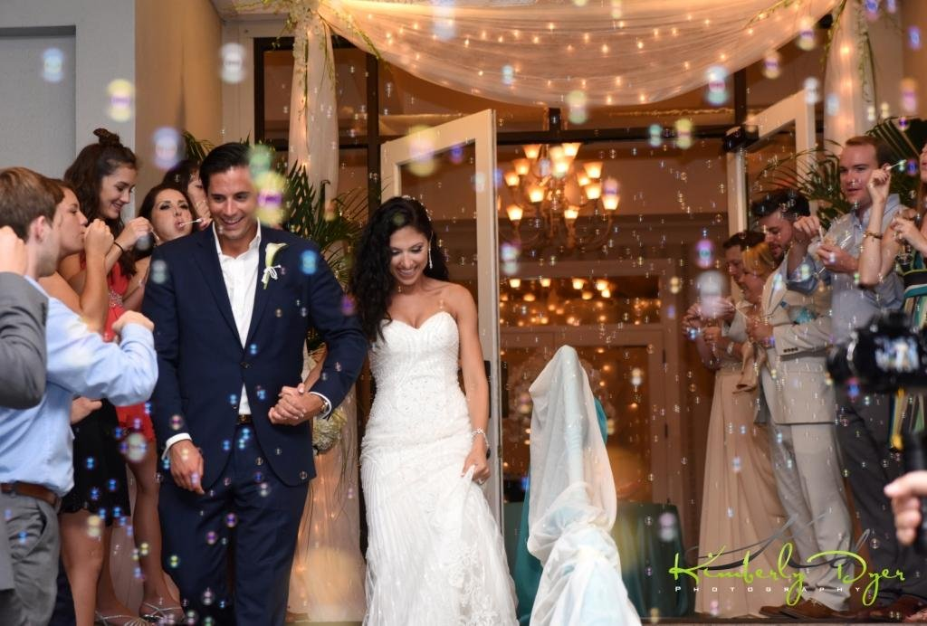 Bride and Groom Entrance to Longboat Key Club with Bubbles