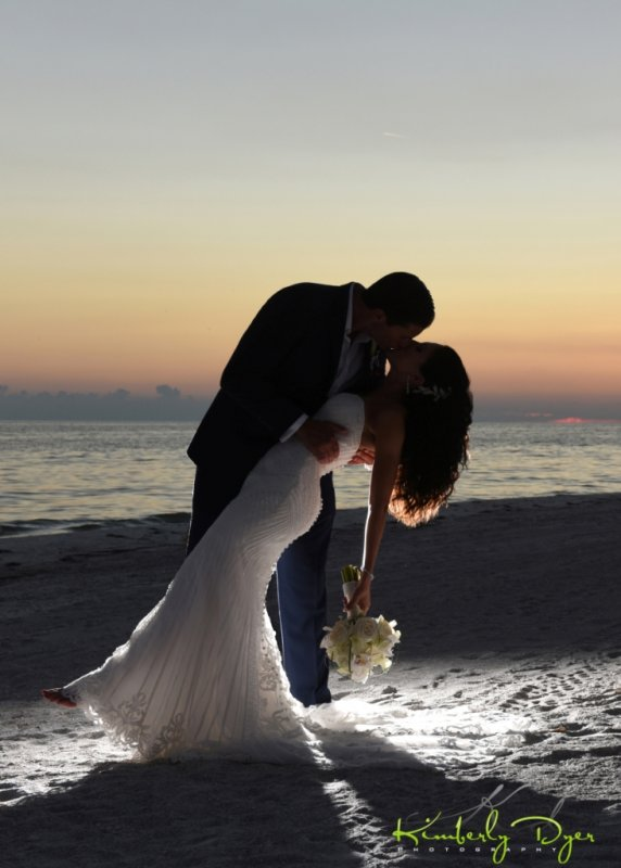 Bride and Groom Sunset Shot with Bouquet
