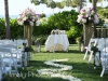 Ceremony Site at Ritz Carlton Facing Water with Columns and Lanterns and Rose Petals