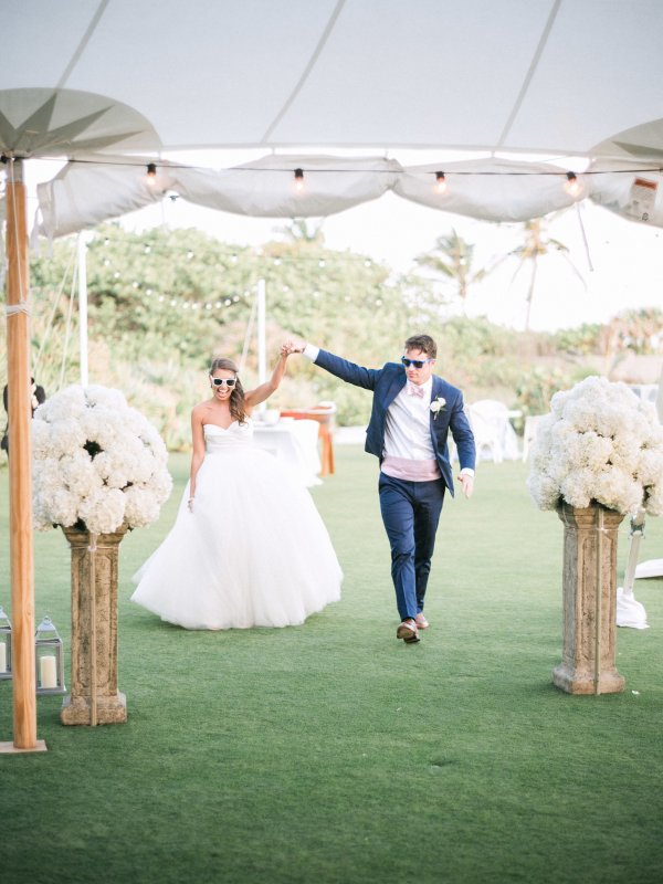 Bride and Groom Entrance to Reception with Hydrangeas on Columns