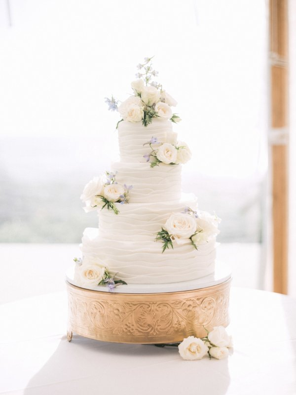 Wedding Cake with White Fresh Roses and Blue Bella Donna Delphinium