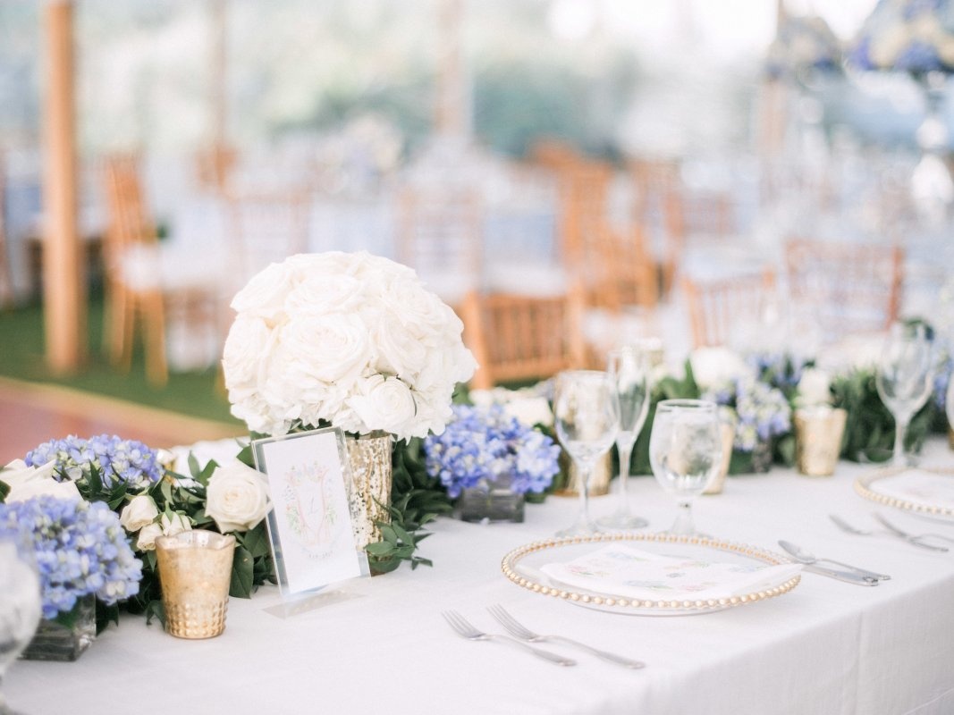 Head Table with Garland and Bridal Bouquet in Gold Vase