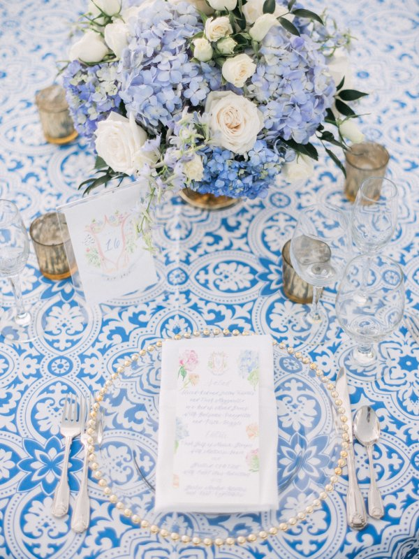 Place setting with Blue Linen and Blue and White Centerpiece