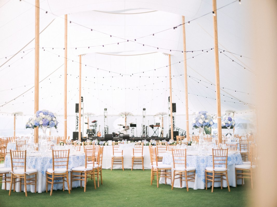 Tent Reception with Blue and White Tall Centerpieces and Head Table