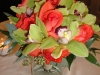 Bridal bouquet coral roses and green cymbidium