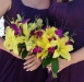 Yellow lilies and purple orchid bridesmaids bouquet