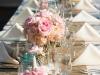 Feasting table with burplap runner and pink flowers in mercury vases