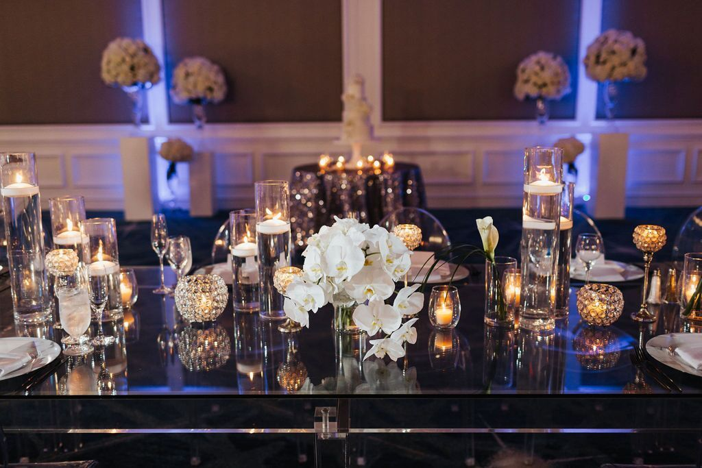 Bridal Bouquet on Head Table with Candles and Flowers