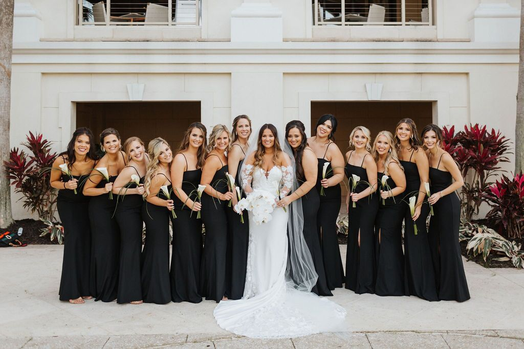 Bride with Bouquet and Bridesmaids with Single Calla Lilies