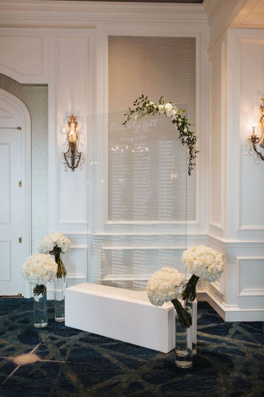 Entry to Ballroom with Garland on Place Card Holders and Flowers from Ceremony