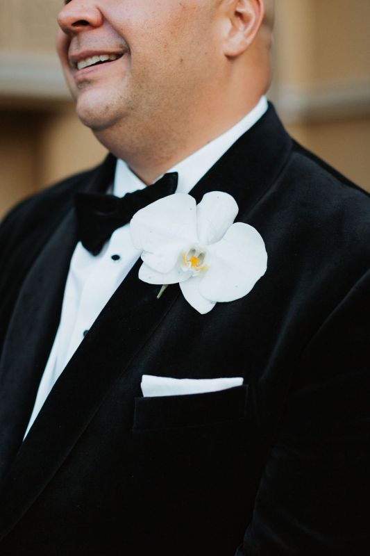 Close Up of Grooms' Orchid Boutonniere