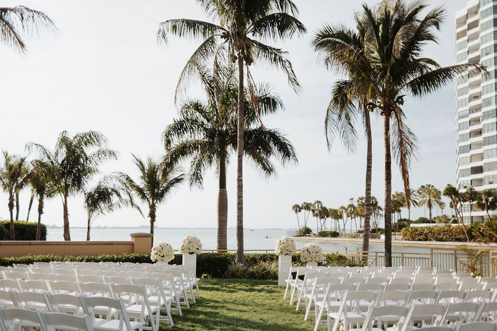 White Columns with White Flowers to Frame Couple at Ceremony